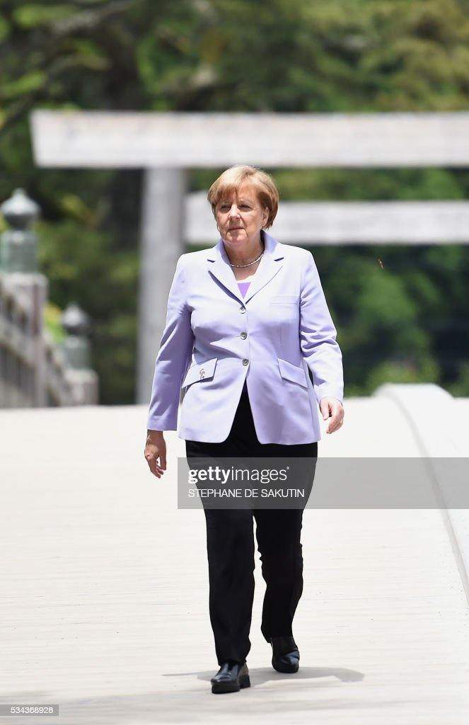 German Chancellor Angela Merkel arrives at Ise-Jingu Shrine in the city of Ise in Mie prefecture, on May 26, 2016, on the first day of the G7 leaders summit. World leaders kick off two days of G7 talks in Japan on May 26 with the creaky global economy, terrorism, refugees, China's controversial maritime claims, and a possible Brexit headlining their packed agenda. / AFP / STEPHANE