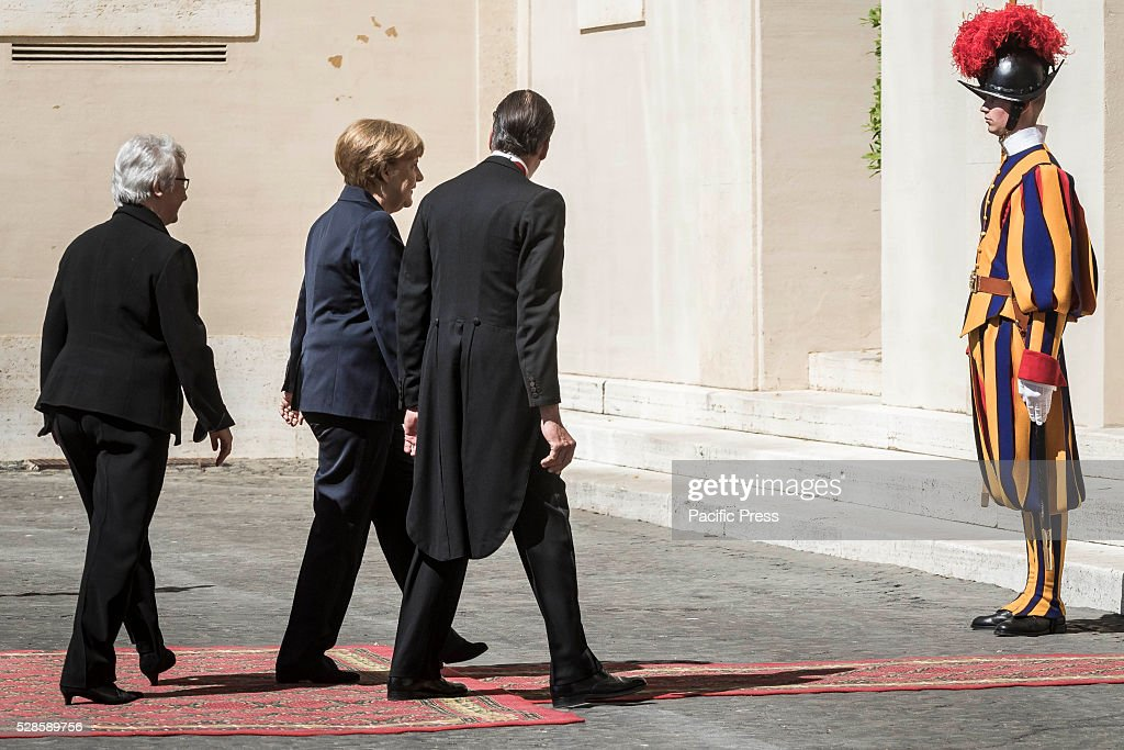 German Chancellor <a gi-track='captionPersonalityLinkClicked' href=/galleries/search?phrase=Angela+Merkel&family=editorial&specificpeople=202161 ng-click='$event.stopPropagation()'>Angela Merkel</a> arrives at the Apostolic Palace to attend a private audience with Pope Francis.