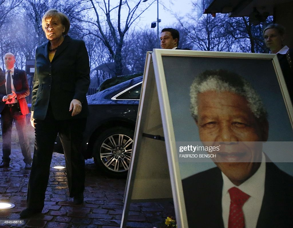 German Chancellor Angela Merkel arrives at the embassy of South Africa in Berlin to write in the book of condolences for the former South African President Nelson Mandela on December 9, 2013. Mandela, the revered icon of the anti-apartheid struggle in South Africa and one of the towering political figures of the 20th century, has died on December 5 aged 95 AFP PHOTO / POOL / FABRIZIO BENSCH