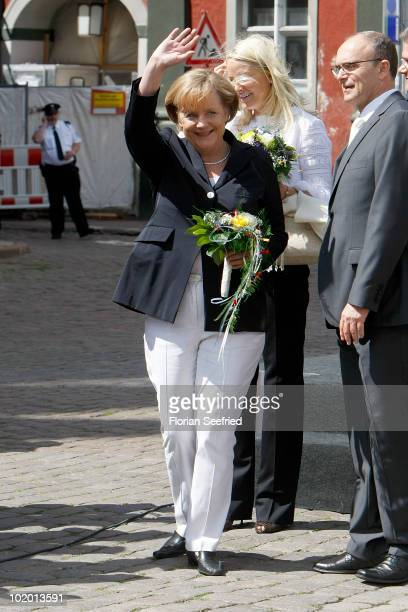German Chancellor Angela Merkel arrives at the market square at Stralsund during the one day visit to northern Germany of Crown Princess MetteMarit...