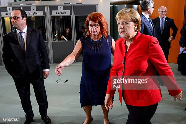 German Chancellor Angela Merkel arrives for a dinner with French President Francois Hollande and European Commission President JeanClaude Juncker at...