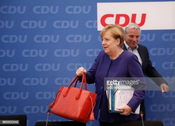 German Chancellor Angela Merkel arrives for a meeting of the federal executive board of the Christian Democratic Union in Berlin on October 23 2017...