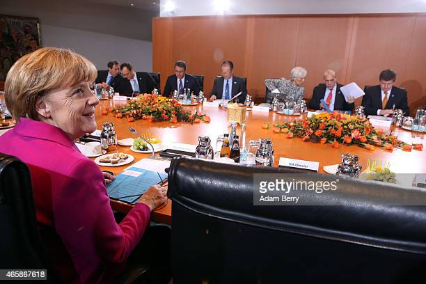 German Chancellor Angela Merkel arrives for a meeting with heads of the world's leading economic and financial organizations at the German federal...