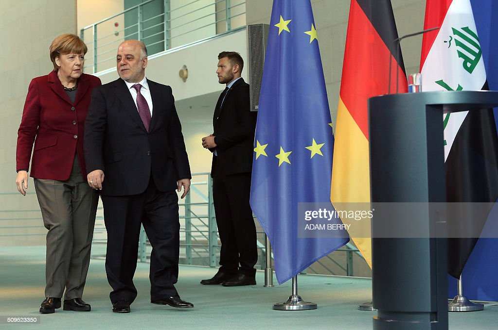 German Chancellor Angela Merkel (L) arrives for a press conference with Iraqi Prime Minister Haider al-Abadi at the Chancellery in Berlin on February 11, 2016. / AFP / Adam BERRY
