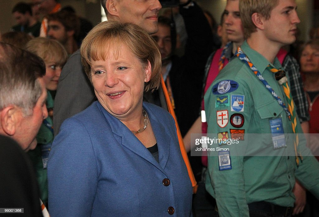 German Chancellor <a gi-track='captionPersonalityLinkClicked' href=/galleries/search?phrase=Angela+Merkel&family=editorial&specificpeople=202161 ng-click='$event.stopPropagation()'>Angela Merkel</a> arrives for delivering a speech during day 3 of the 2nd Ecumenical Church Day (2. Oekumenischer Kirchentag) at International Congress Center (ICC) on May 14, 2010 in Munich, Germany. Thousands will travel to the southern German city to take part in the Church Day events been held from May 12 to May 16, 2010.