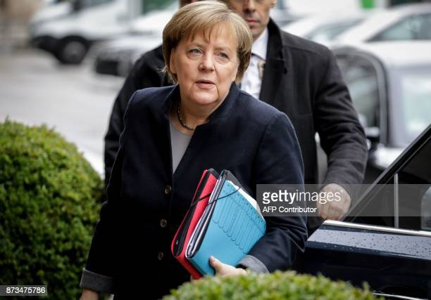 German Chancellor Angela Merkel arrives for further exploratory talks with members of potential coalition parties to form a new government on...