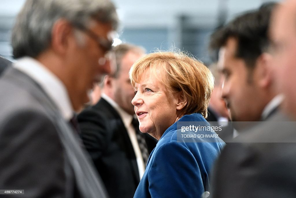 German Chancellor Angela Merkel arrives for the start of the seventh socalled National Integration Summit hosted by the German government at the...