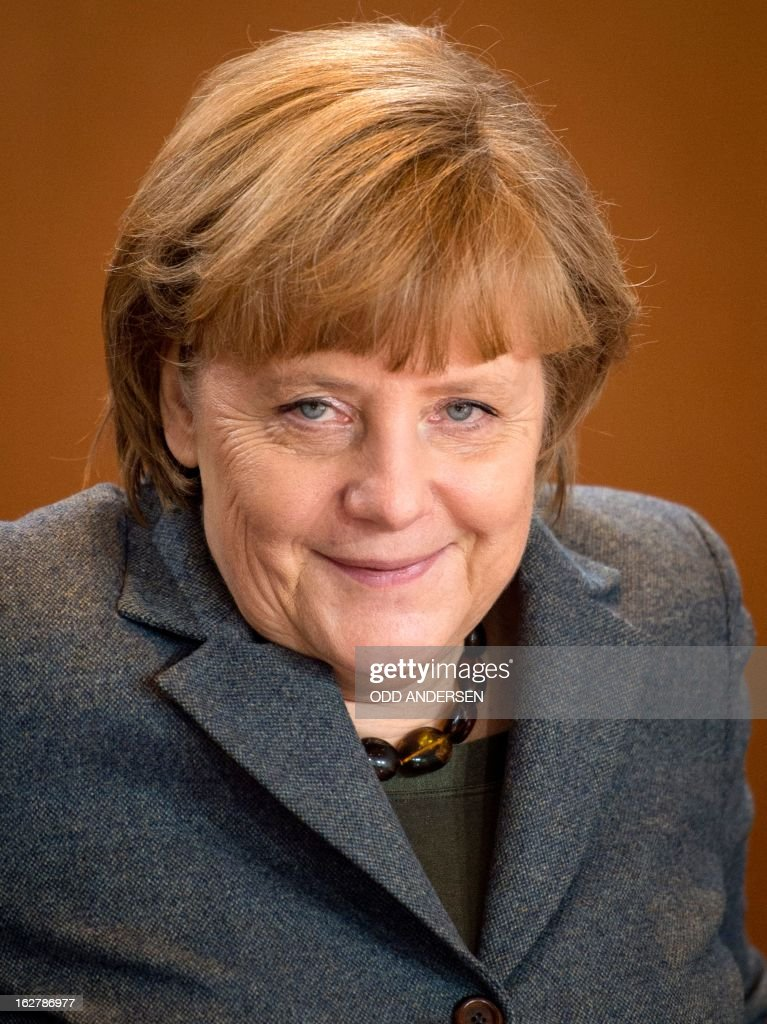 German Chancellor Angela Merkel (R) arrives for the weekly cabinet meeting at the Chancellery in Berlin, Germany on February 27, 2013.