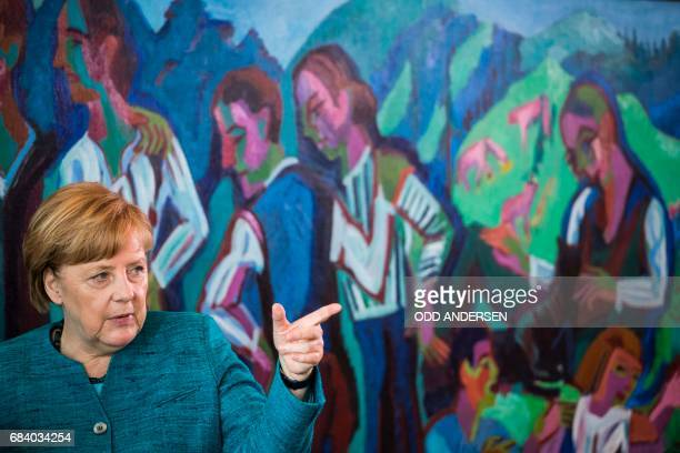 German Chancellor Angela Merkel arrives for the weekly cabinet meeting at the Chancellery in Berlin on May 17 2017 / AFP PHOTO / Odd ANDERSEN