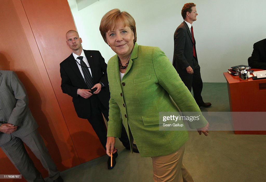 German Chancellor Angela Merkel arrives for the weekly German government cabinet meeting at the Chancellery on June 29, 2011 in Berlin, Germany. High on the morning's agenda was the continued participation of German troops and police in the UNAMID mission in Darfur.