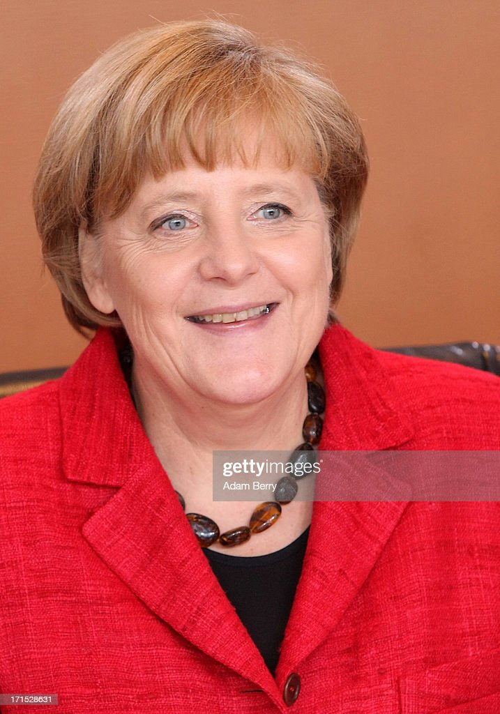 German Chancellor <a gi-track='captionPersonalityLinkClicked' href=/galleries/search?phrase=Angela+Merkel&family=editorial&specificpeople=202161 ng-click='$event.stopPropagation()'>Angela Merkel</a> arrives for the weekly German federal Cabinet meeting on June 26, 2013 in Berlin, Germany. High on the morning's agenda was a discussion concerning the country's 2014 federal budget.
