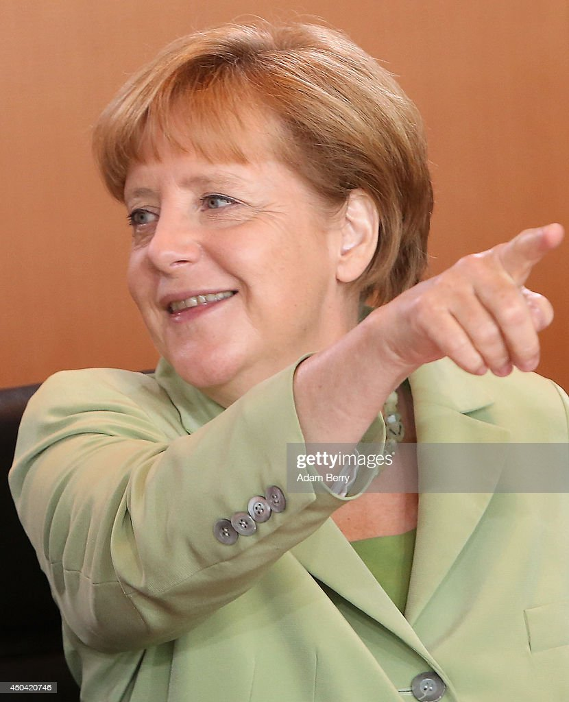 German Chancellor <a gi-track='captionPersonalityLinkClicked' href=/galleries/search?phrase=Angela+Merkel&family=editorial&specificpeople=202161 ng-click='$event.stopPropagation()'>Angela Merkel</a> (CDU) arrives for the weekly German federal Cabinet meeting on June 11, 2014 in Berlin, Germany. High on the meeting's agenda was discussion over the country's arms export policies.
