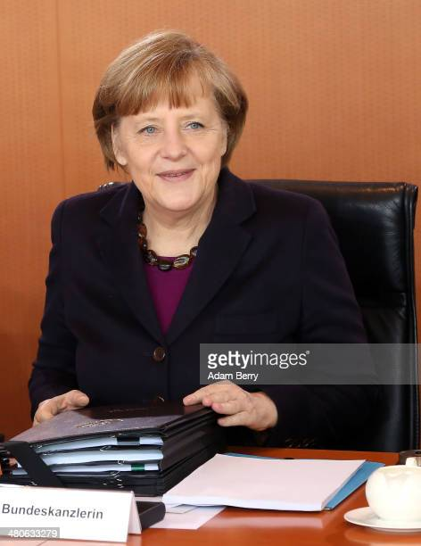 German Chancellor Angela Merkel arrives for the weekly German federal government Cabinet meeting on March 26 2014 in Berlin Germany High on the...