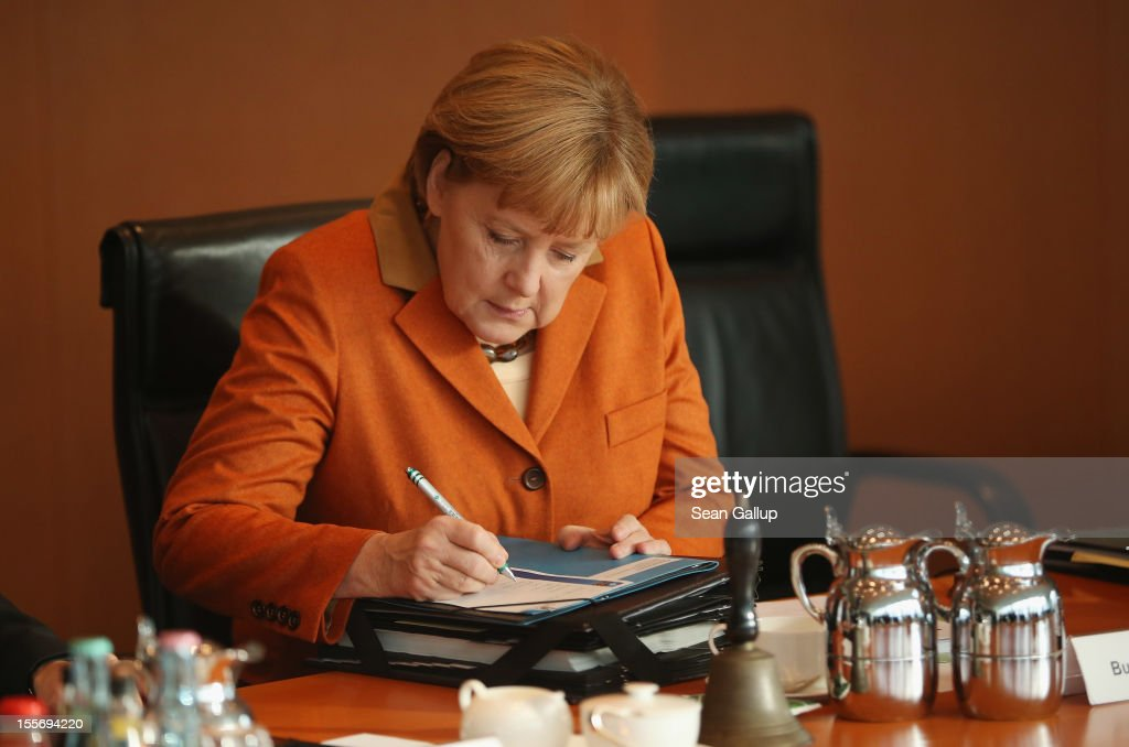 German Chancellor <a gi-track='captionPersonalityLinkClicked' href=/galleries/search?phrase=Angela+Merkel&family=editorial&specificpeople=202161 ng-click='$event.stopPropagation()'>Angela Merkel</a> arrives for the weekly German government cabinet meeting on November 7, 2012 in Berlin, Germany. Merkel is scheduled to travel to London later today to meet with British Prime Minister David Cameron for talks concerning the budget of the European Union.