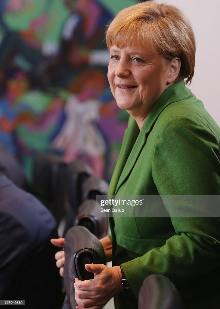 German Chancellor <a gi-track='captionPersonalityLinkClicked' href=/galleries/search?phrase=Angela+Merkel&family=editorial&specificpeople=202161 ng-click='$event.stopPropagation()'>Angela Merkel</a> arrives for the weekly German government cabinet meeting on November 28, 2012 in Berlin, Germany. High on the morning's agenda was changes to the country's pension system.