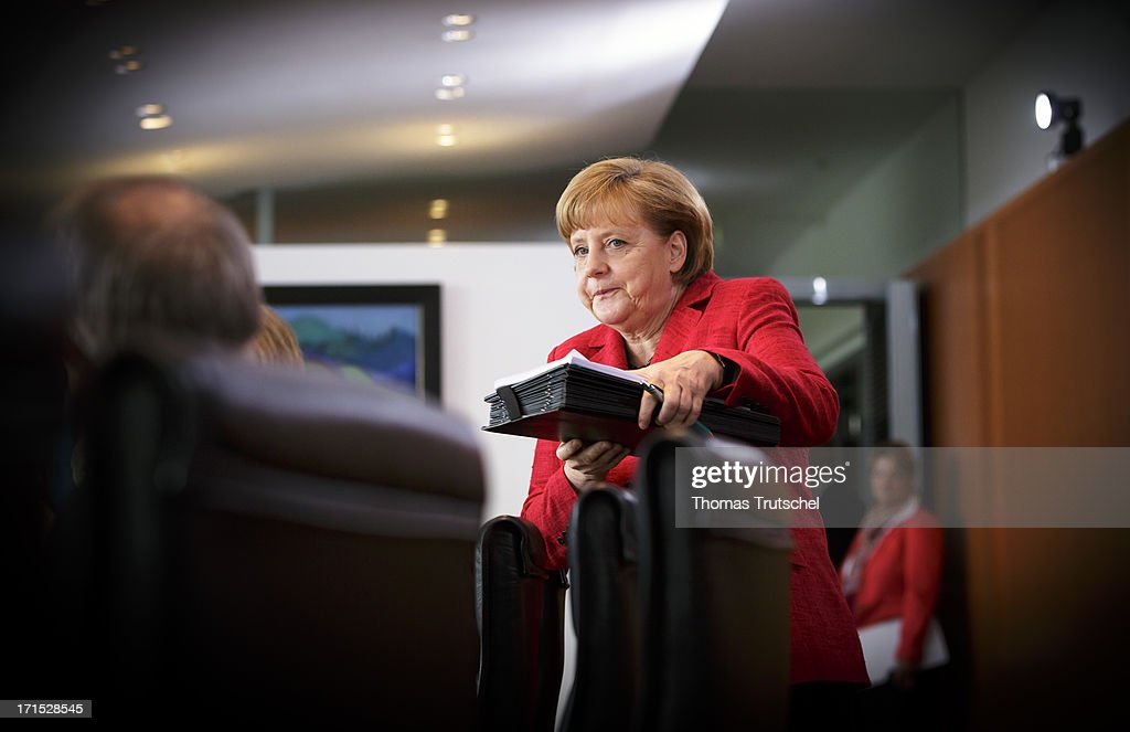 German Chancellor <a gi-track='captionPersonalityLinkClicked' href=/galleries/search?phrase=Angela+Merkel&family=editorial&specificpeople=202161 ng-click='$event.stopPropagation()'>Angela Merkel</a> arrives for Weekly German Government Cabinet Meeting on June 26 2013 in Berlin, Germany.