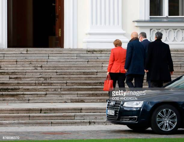 German Chancellor Angela Merkel arrives in her car at the presidential residence Bellevue Castle in Berlin to meet the German President on November...