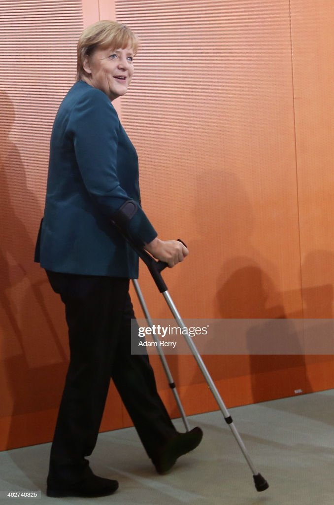 German Chancellor Angela Merkel (CDU) arrives on crutches after a ski accident for the weekly German federal Cabinet meeting on January 15, 2014 in Berlin, Germany. High on the morning's agenda was discussion on a 2012 report on immigration.