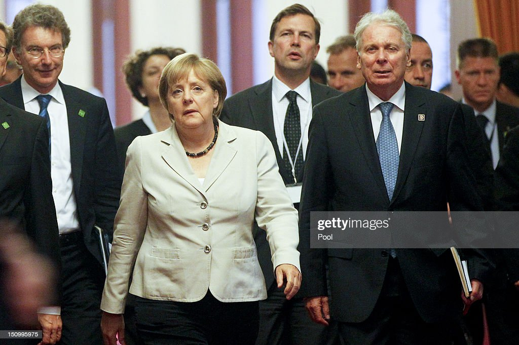 German Chancellor <a gi-track='captionPersonalityLinkClicked' href=/galleries/search?phrase=Angela+Merkel&family=editorial&specificpeople=202161 ng-click='$event.stopPropagation()'>Angela Merkel</a> (C) arrives to a meeting with Chinese President Hu Jintao (not pictured) at the Great Hall of the People on August 30, 2012 in Beijing, China. Merkel is on a two-day official visit to China.
