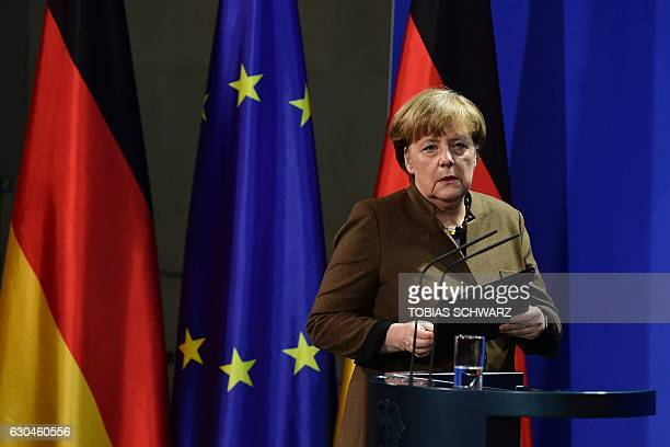 German Chancellor Angela Merkel arrives to address a press conference at the Chancellery in Berlin on December 23 2016 after Tunisian Anis Amri the...