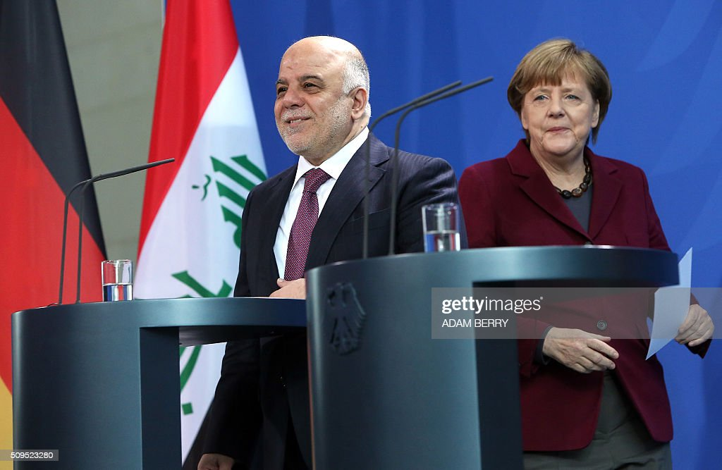 German Chancellor Angela Merkel (R) arrives to give a joint press conference with Iraqi Prime Minister Haider al-Abadi after meeting at the Chancellery in Berlin on February 11, 2016. / AFP / Adam BERRY