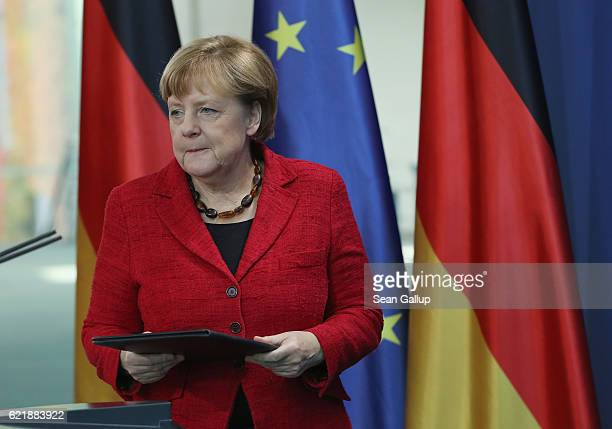 German Chancellor Angela Merkel arrives to give a statement to the media following the victory by US Republican candidate Donald Trump in US...