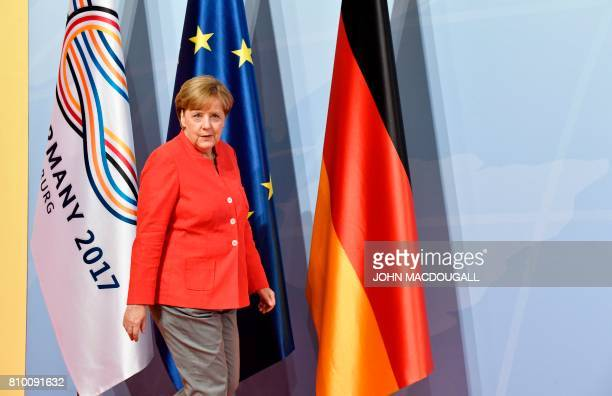 German Chancellor Angela Merkel arrives to greet heads of State attending the G20 meeting in Hamburg northern Germany on July 7 Leaders of the...
