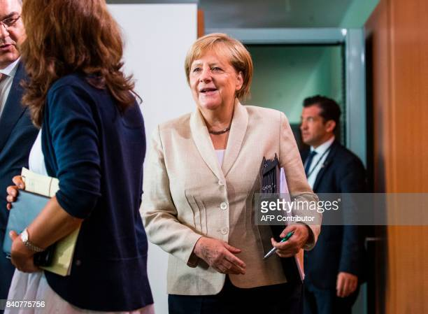 German Chancellor Angela Merkel arrives to lead the weekly cabinet meeting on August 30 2017 at the Chancellery in Berlin / AFP PHOTO / Odd ANDERSEN