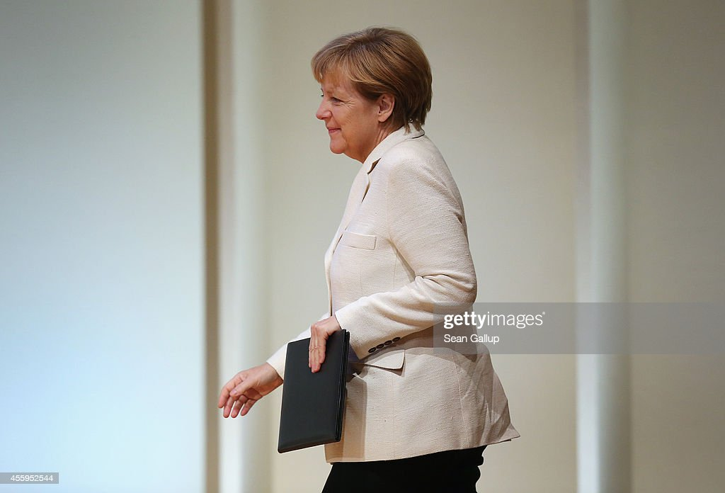 German Chancellor Angela Merkel arrives to speak at the annual congress of the German Federation of Industry on September 23 2014 in Berlin Germany...