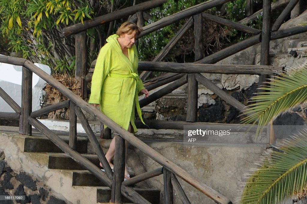 German Chancellor Angela Merkel arrives to take a bath in the swimming pool of the Aphrodite Terme in the coastal town of Sant'Angelo d'Ischia on the southern Italy's Island of Ischia during their Easter holiday on March 31, 2013.