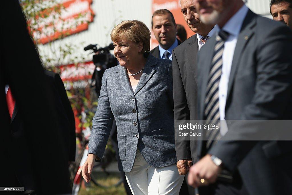 merkel visits heidenau asylum shelter following violent