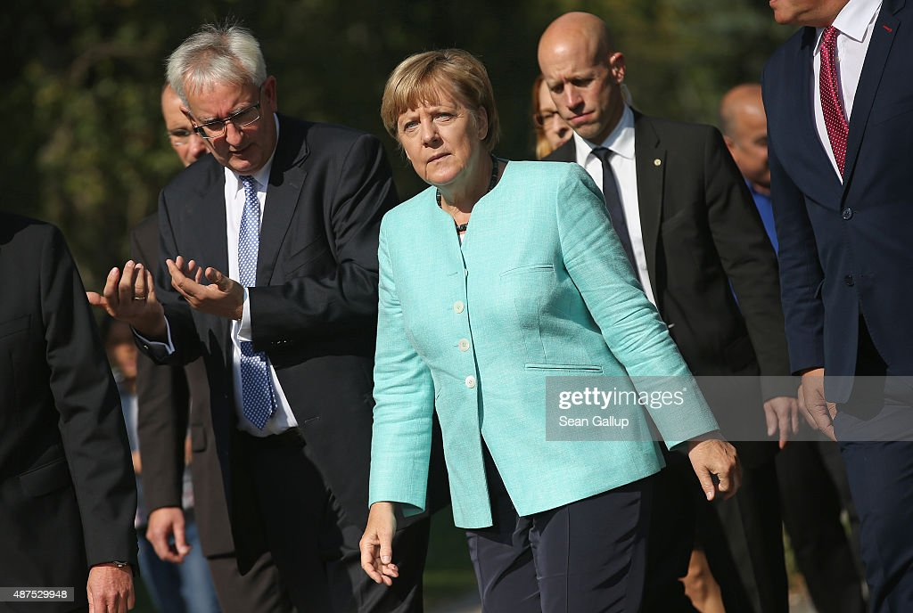 German Chancellor Angela Merkel arrives to visit the AWO Refugium Askanierring shelter for migrants on September 10, 2015 in Berlin, Germany. Merkel visited several facilities for migrants today, including an application center for asylum-seekers, a school with welcome classes for migrant children and a migrant shelter. Thousands of migrants are currently arriving in Germany every day, most of them via the Balkans and Austria. Germany is expecting to receive 800,000 asylum applicants this year.
