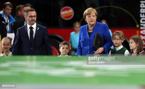German Chancellor Angela Merkel arrives with children and Alfons Hoelzl president of the German Gymnastics Associaion during the Stadium Gala of the...