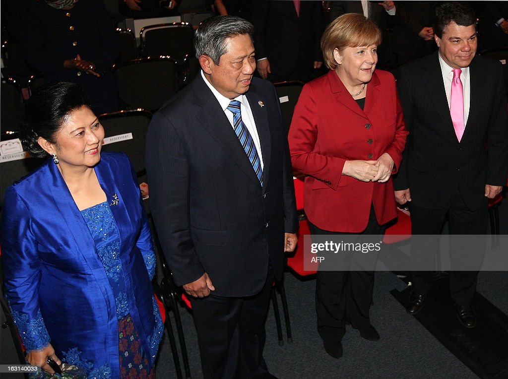 German Chancellor Angela Merkel (2nd R) arrives with Indonesian President Susilo Bambang Yudhoyono (2nd L), his wife Kristiani Herawati (L) and the CEO of Messe Berlin fair operator Raimund Hosch for the opening of the ITB Berlin international travel trade show in Berlin on March 5, 2013. Indonesia is this year's partner country of the fair running until March 10, 2013.
