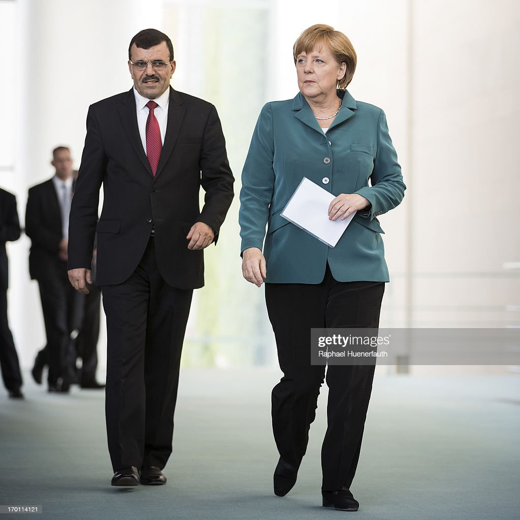 German Chancellor <a gi-track='captionPersonalityLinkClicked' href=/galleries/search?phrase=Angela+Merkel&family=editorial&specificpeople=202161 ng-click='$event.stopPropagation()'>Angela Merkel</a> arrives with Prime Minister of Tunisia Ali Laarayedh at a press conference on June 07, 2013 at the Federal Chancellery in Berlin, Germany.