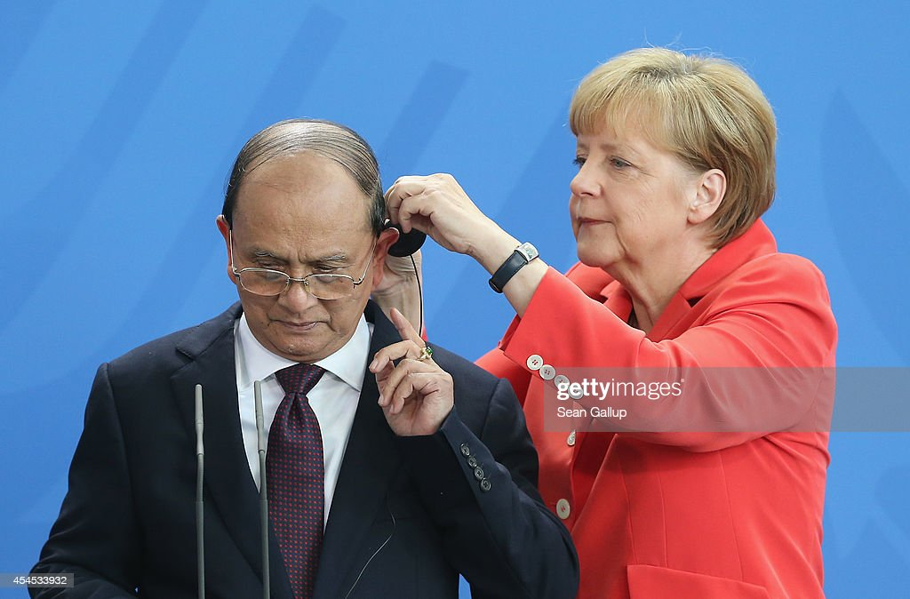German Chancellor <a gi-track='captionPersonalityLinkClicked' href=/galleries/search?phrase=Angela+Merkel&family=editorial&specificpeople=202161 ng-click='$event.stopPropagation()'>Angela Merkel</a> assists Myanmar President <a gi-track='captionPersonalityLinkClicked' href=/galleries/search?phrase=Thein+Sein&family=editorial&specificpeople=787536 ng-click='$event.stopPropagation()'>Thein Sein</a> with his headphone prior to speaking to the media following bilateral talks at the Chancellery on September 3, 2014 in Berlin, Germany. President <a gi-track='captionPersonalityLinkClicked' href=/galleries/search?phrase=Thein+Sein&family=editorial&specificpeople=787536 ng-click='$event.stopPropagation()'>Thein Sein</a> is on a two-day visit to Germany, during which he will also meet with German President Gauck and Bundestag President Lammert.