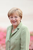 German Chancellor Angela Merkel attend a welcoming ceremony by Chinese Premier Li Keqiang outside the Great Hall of the People on July 7 2014 in...