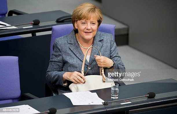 German Chancellor Angela Merkel attend the debate on financial aid for Greece in German Bundestag on August 19 2015 in Berlin Germany