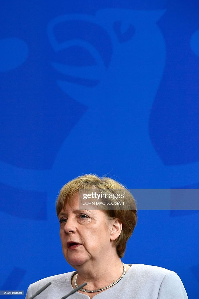 German chancellor Angela Merkel attends a joint press conference with the Ukraininian Prime Minister after talks at the chancellery in Berlin on June 27, 2016. / AFP / John MACDOUGALL