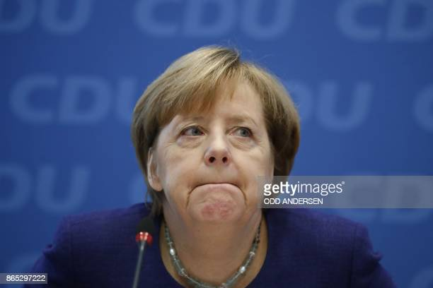 German Chancellor Angela Merkel attends a meeting of the federal executive board of the Christian Democratic Union in Berlin on October 23 2017 on...