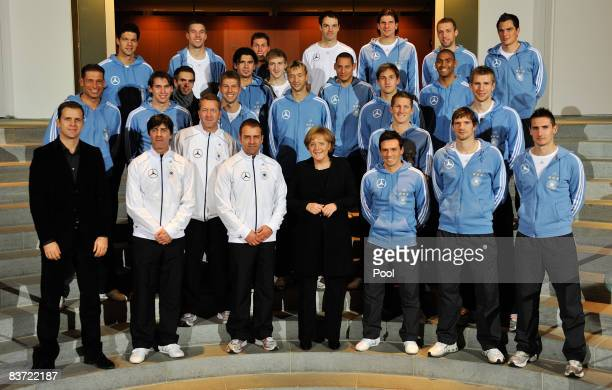 German Chancellor Angela Merkel attends a photocall with members of the German national football team at the Skylobby of the Chancellory on November...