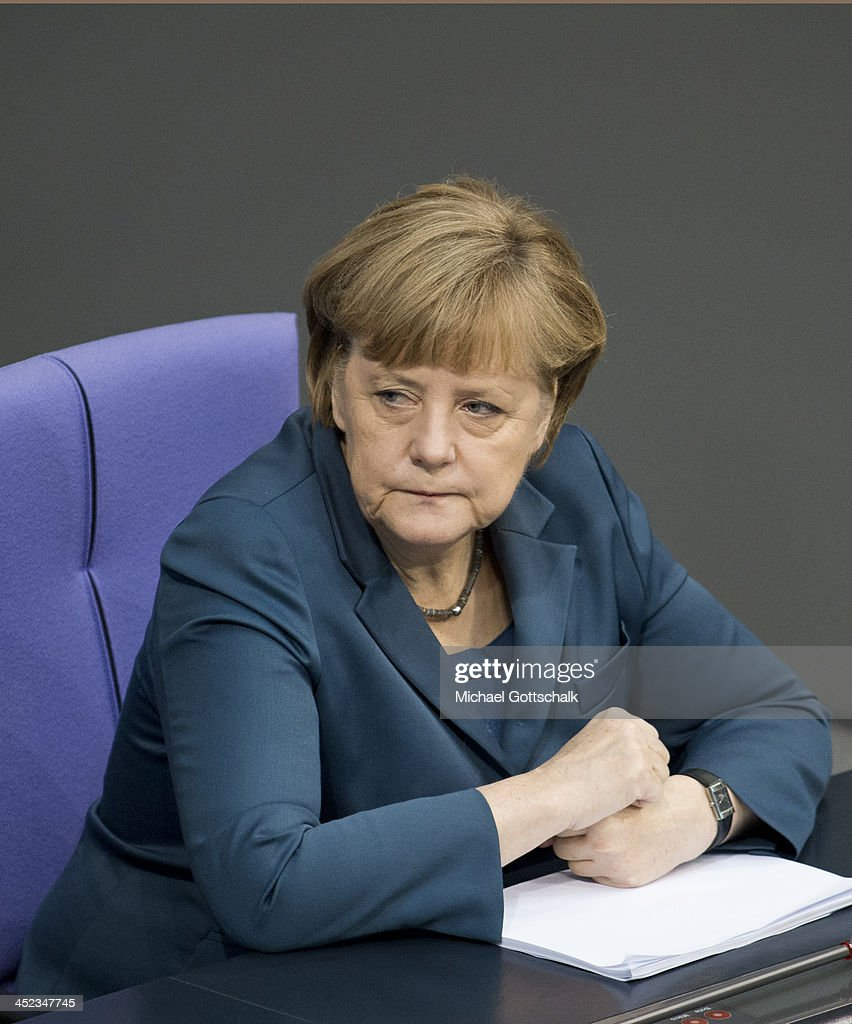 German Chancellor <a gi-track='captionPersonalityLinkClicked' href=/galleries/search?phrase=Angela+Merkel&family=editorial&specificpeople=202161 ng-click='$event.stopPropagation()'>Angela Merkel</a>, attends a plenary session in German Bundestag on November 28, 2013 in Berlin, Germany. The Bundestag debates the extensions of Bundeswehr mission in South-Sudan.