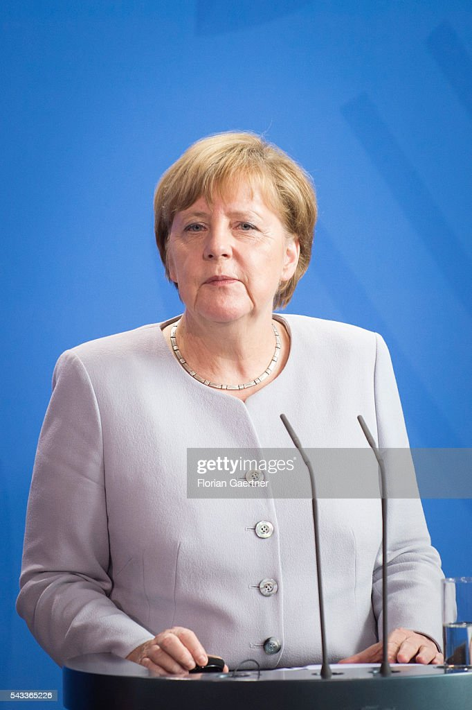 German Chancellor <a gi-track='captionPersonalityLinkClicked' href=/galleries/search?phrase=Angela+Merkel&family=editorial&specificpeople=202161 ng-click='$event.stopPropagation()'>Angela Merkel</a> attends a press conference on June 27, 2016 in Berlin, Germany. Merkel hosted talks with Hollande and Renzi to discuss the UK's decision to leave the European Union.