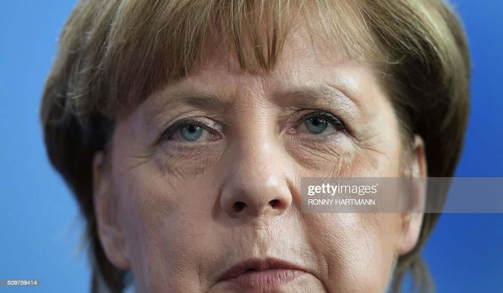 German Chancellor Angela Merkel attends a press statement at the Chancellery in Berlin on February 12, 2016. / AFP / Ronny Hartmann