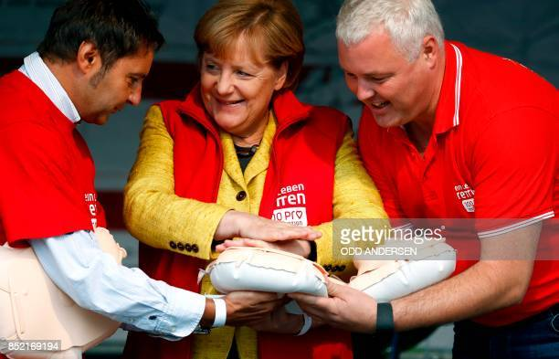 German Chancellor Angela Merkel attends a reanimation course and contest organized by the medical university of northeastern town of Greifswald on...