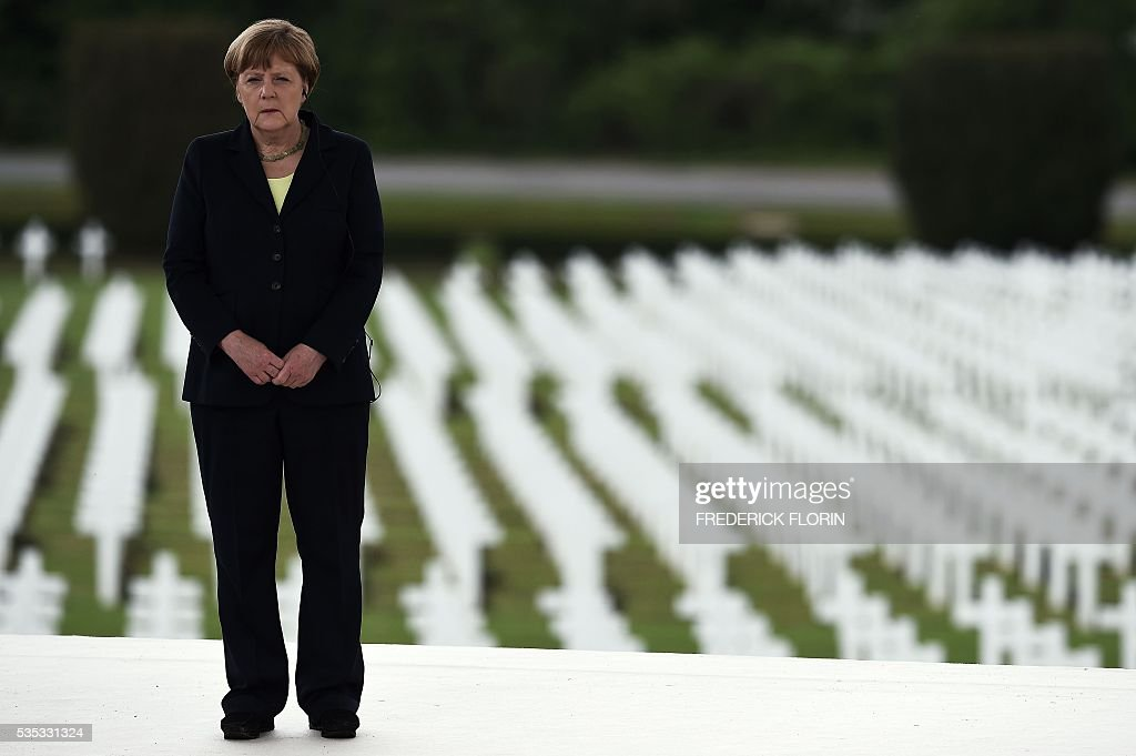 German Chancellor Angela Merkel attends a remembrance ceremony to mark the centenary of the battle of Verdun, at the Douaumont Ossuary (Ossuaire de Douaumont), northeastern France, on May 29, 2016. The battle of Verdun, in 1916, was one of the bloodiest episodes of World War I. The offensive which lasted 300 days claimed more than 300,000 lives. / AFP / FREDERICK
