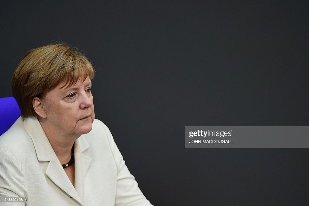 German Chancellor Angela Merkel waits prior a special plenary session on Brexit at the German lower house of Parliament Bundestag in Berlin, on June 28, 2016. / AFP / John MACDOUGALL