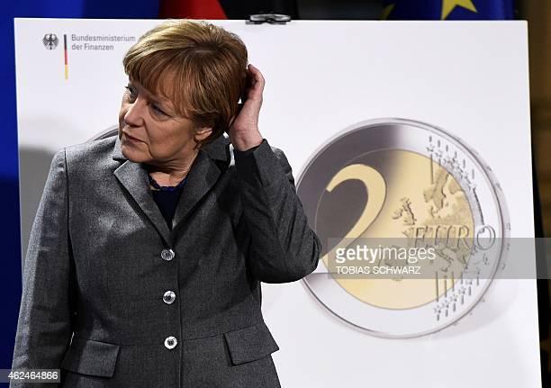German Chancellor Angela Merkel attends a twoeurocoin presentation in Berlin on January 29 2015 AFP PHOTO / TOBIAS SCHWARZ