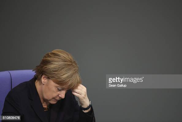 German Chancellor Angela Merkel attends debates after she addressed the Bundestag in a government statement ahead of tomorrow's European Union summit...