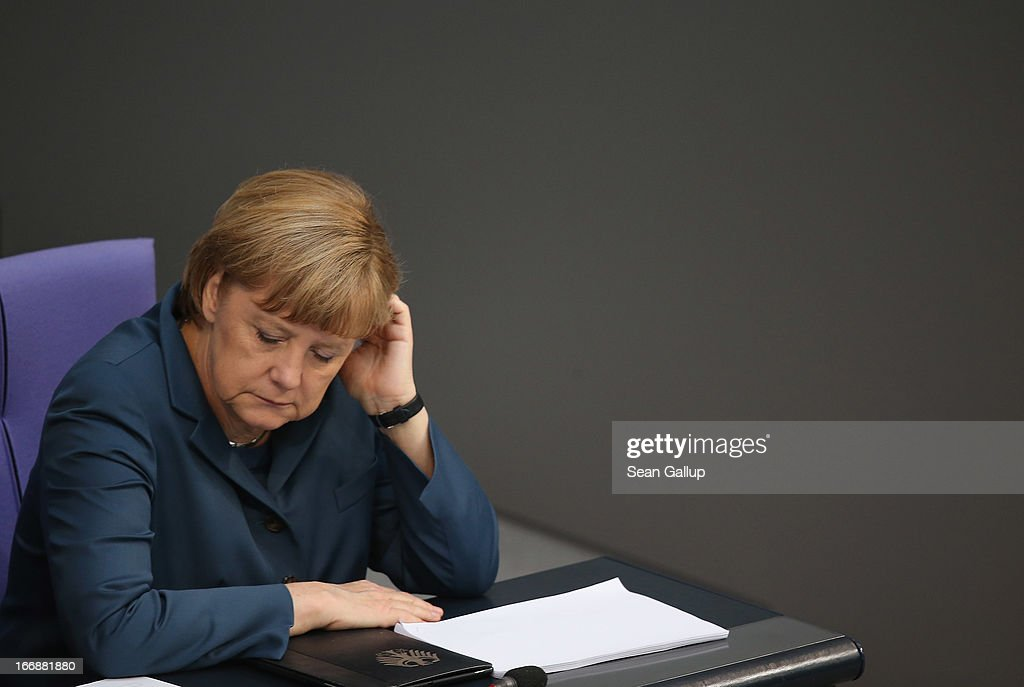 German Chancellor <a gi-track='captionPersonalityLinkClicked' href=/galleries/search?phrase=Angela+Merkel&family=editorial&specificpeople=202161 ng-click='$event.stopPropagation()'>Angela Merkel</a> attends debates over EU finanical aid to Cyprus at the Bundestag on April 18, 2013 in Berlin, Germany. The Bundestag will vote later today whether to pass ESM support for Cyprus, which will help Cyprus banks with EUR 10 biilion.